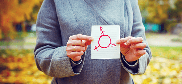 Person holding drawing of gender symbol