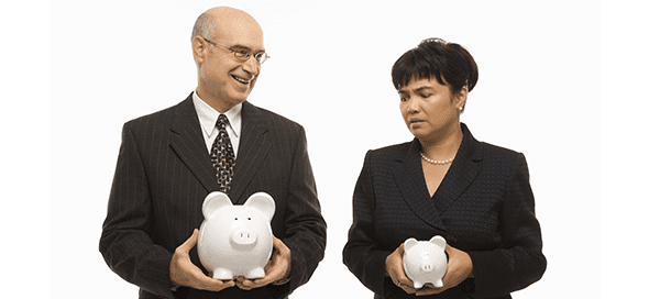 Man holding a large piggy bank and woman holding a small piggy bank