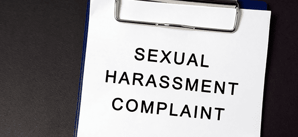 "Clipboard with a piece of paper on it that says ""sexual harassment complaint"""